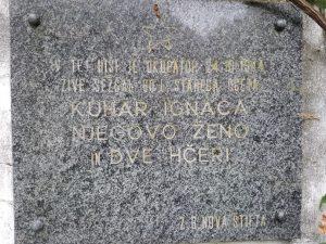 Spominska plošča na Nacetovi hiši v Tiroseku v spomin žrtev požiga domačije